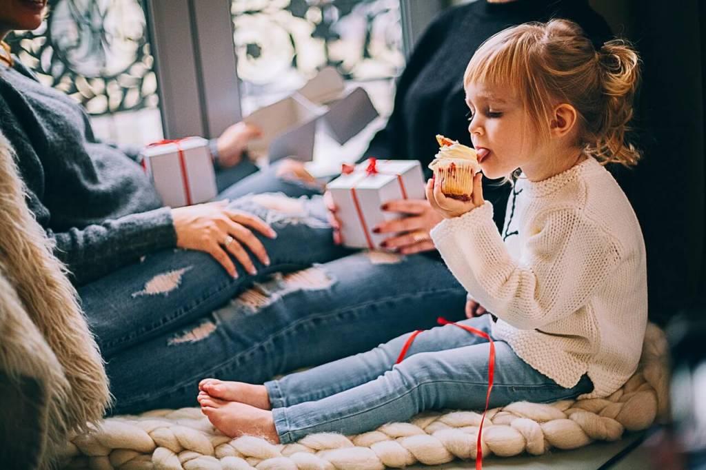 little girl eating new year cake