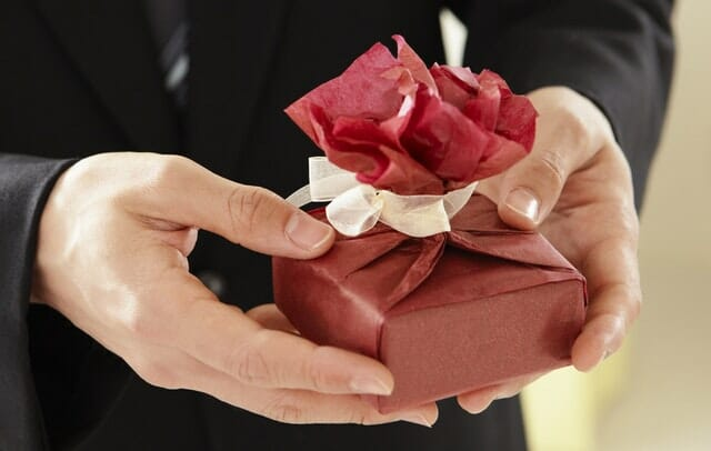 Husband getting valentine day gift for wife
